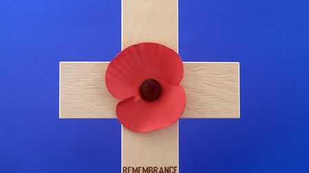 Remembrance Day Poppy on wooden cross