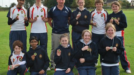 The archery medal winners with coach Sean Fox.