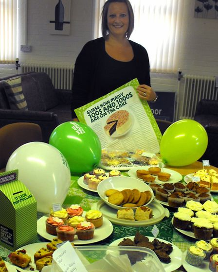 Sarah Timbrell, with all the cakes made and brought into school for the MacMillan Coffee Morning.