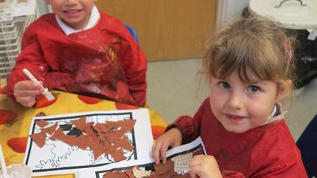 Great Dunmow Primary Reception Class pupils with their woodland creature collages.