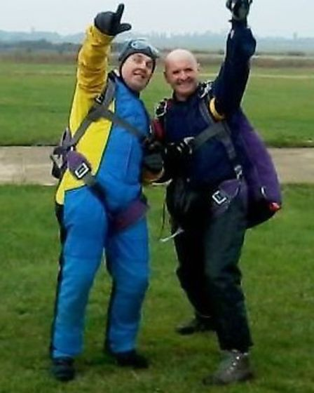 Sarah's husband Andrew celebrates completing his skydive.