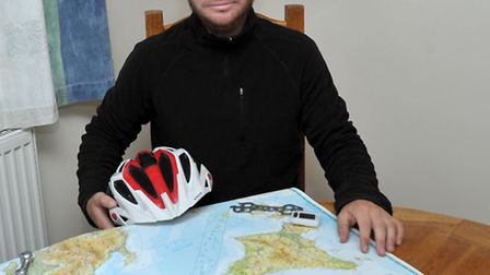 Daniel Doughty with his map and cycle tool kit that he took on the 8000 mile cycle ride across Japan