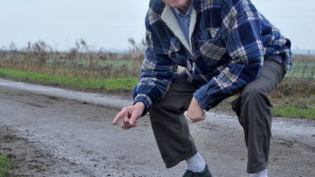 Block Fen road. Ieuan Williams pointing out the mud and damage to verge.