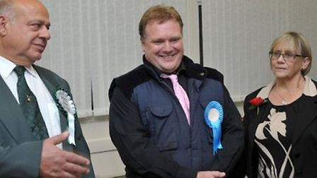 Steve Tierney (centre) in October when he won the Medworth by election for Fenland Council