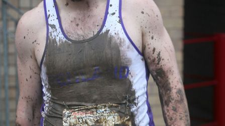 FRC competitor Dean Clark got covered in mud during his leg.