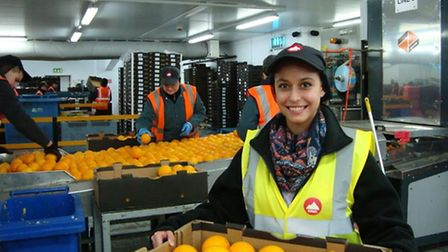 Fabiola in ERMS packing area giving the team a helping hand.