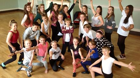 Young performers rehearsing their roles for King's Lynn Corn Exchange's pantomime, Snow White and th