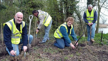 Tree planting in the Manea woods near to the recreation ground. L2R Mark Archer, Robin Hicks, Pat Sm