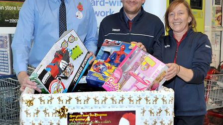 Tesco staff in March, Joy and James Burton have organised a Christmas collection box for new toys an