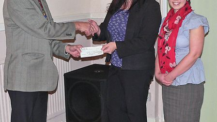Rotarian Godfrey Smith President of the Rotary Club of March presented a donation of £100 to Vanessa