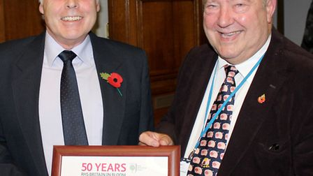 Presenting a special certificate to Brian Massingham, chairman of Wisbech In Bloom, Councillor Peter