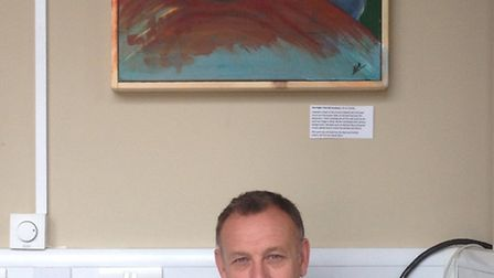 Michelle Hayward's husband Paul with one of her paintings