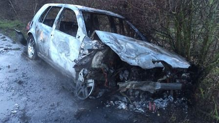 The VW Golf which Connor Lucas smashed his way out of moments before it burst into flame