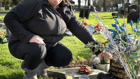 Graves flood at chatteris cemetery. Rose Jacobs at her sons grave. Picture: Steve Williams.