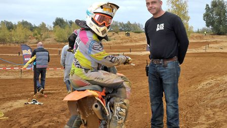 Mepal MX Track. Martin Wright from F15MX with one of the riders ready to go on track.