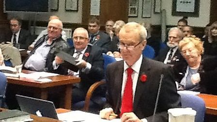 Cllr Clark (front, red tie) during the Estoverdebate at Fenland Hall last month.