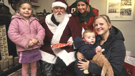Santas Grotto at Ely Museum, (l-r) Amy Williams, Father Christmas, Elf Clare Mansfield, Jared Willia