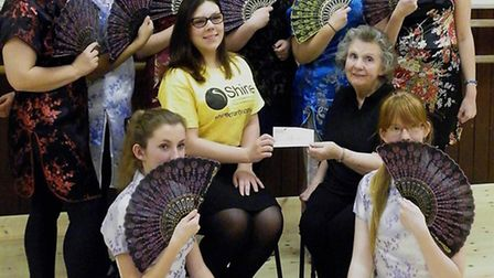 Vera Francis presents oney to charity