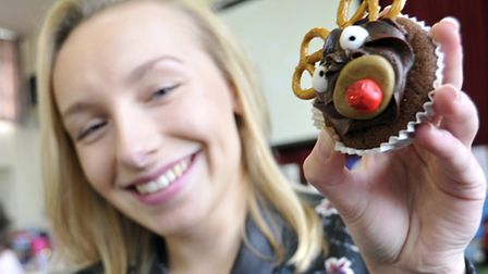 Soham Village College Christmas Fair, Year 11 pupil, Olivia with her cakes
