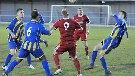 Tommy Treacher, surrounded by three Huntingdon players, attempts to control the ball. Picture: Steve
