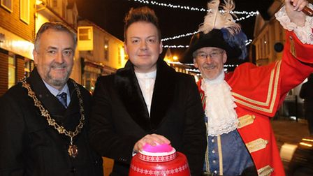 Mayor Jonathan Cadwallader, singer James Ford and town cryer Richard Harris at the lights switch on.