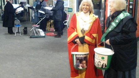 The mayor of Ely, Councillor Lis Every, raises funds for the NSPCC at Ely railway station.