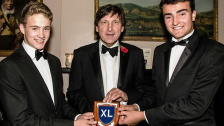 Jacob Maton, left, and Edward Goff, right, collect their Forty Club award.