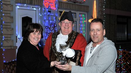 Winner of the Christmas decorated house. Left: Karen and Alan Howlett with Mayor of March cllr Kit O