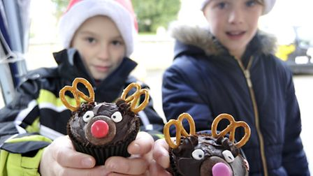 Stretham Christmas Farmers Market, (l-r) Jake, and Lily, with their reindeer cakes.