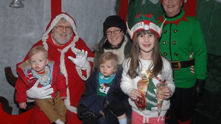 Joshua and Samuel Dowle, one, met Father Christmas for the first time with their mum Kelly.