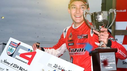George Russell with his cheque and trophy for winning the BRDC British Formula 4 championship.