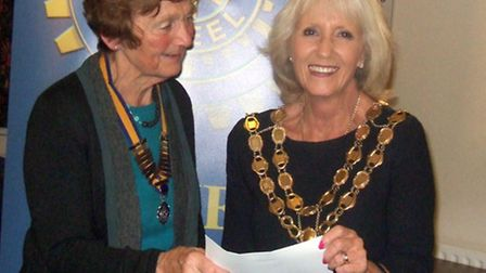 Helen Shanassy, left, presents the cheque to Cllr Lis Every.
