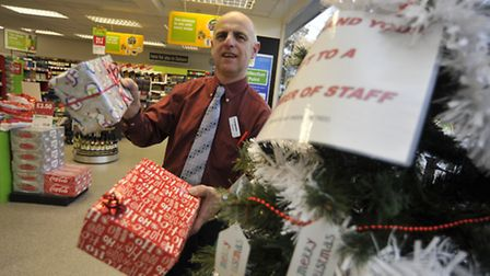 Co-Op, Soham, Christmas Giving Tree, Store Manager Richard Hawes, with some of the gifts.
