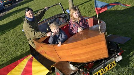 Jacob Sams, 4, and Francesca Sams, 7, go for a 'flight' with John Rothwell in the world's only thre