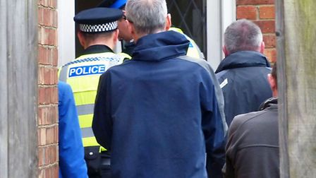 Officers entering a house in Colvile Road, Wisbech, as part of Operation Pheasant.
