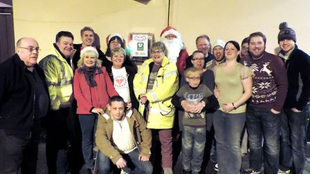 Whittlesey Lions present defibrillator which is on the wall of the Letter B in London Street, Whittl