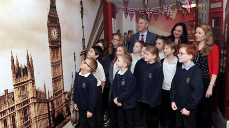 MP Steve Barclay, pupils and staff marvel at the decorated corridor.