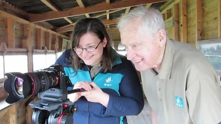 A volunteer learns how to film. Picture: Adam Finch.