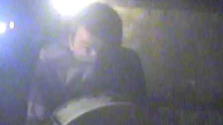 A CCTV image of a man police would like to speak to in connection with a series of burglaries.