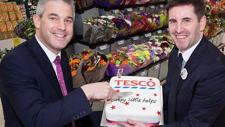 A new Tesco in Wisbech DID open a year ago and MP Steve Barclay was on hand to cut a cake to celebra