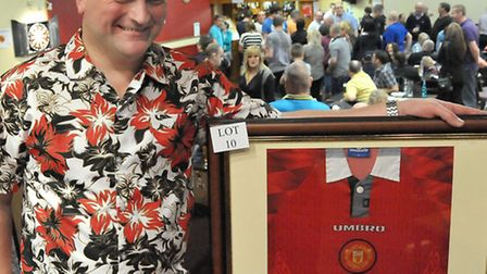 Mark Cross with one of the auction lots at last year's event. Picture: Steve Williams.