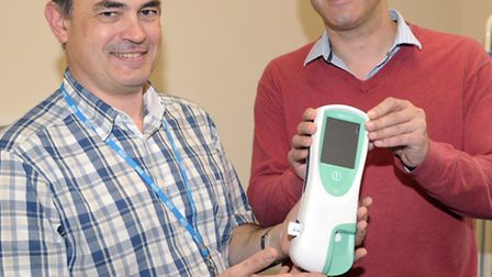 Dr Simon Hambling and Steve Barclay MP with the Cobas machine.