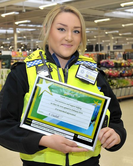 Police Contact Point meeting, Tesco, Wisbech. Pcso Megan Sargent with the certifacate from Tesco. Pi