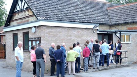 Members of the public queued out the door to attend a public meeting at Wimblington Parish Hall abou
