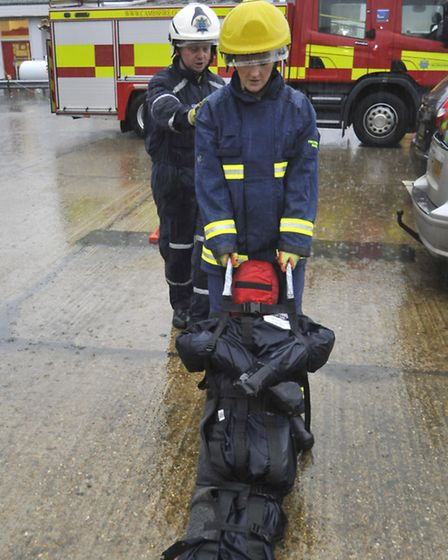 Kath Sansom pulls an 8st 7lb dummy during one of the training drills, watched by training instructor