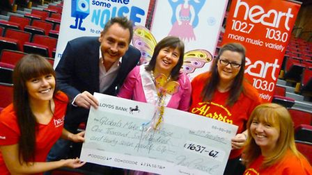 Cresset staff and Kev Lawrence of Heart FM present the cheque to Carole Hughes, of Anna's Hope.