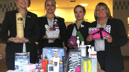 Pictured with the Christmas gifts are Waitrose staff Natalie Laverick, Bryony Mason, Chloe Brand and