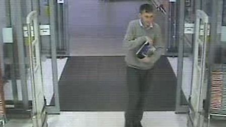 Police would like to speak to this man in connection with an act of fraud at Sainsbury's in Ely.