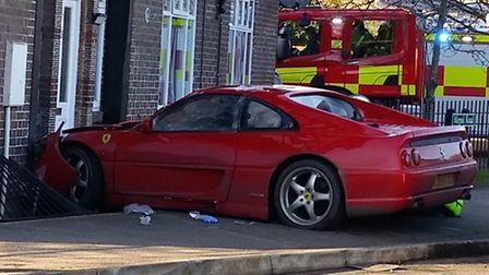 The Ferrari avoided crashing into a house by just feet, coming to a stop on some metal railings. Pic