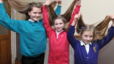 3 sisters having hair cut for Little Princess trust and also to raise money for Billy lee charity. S